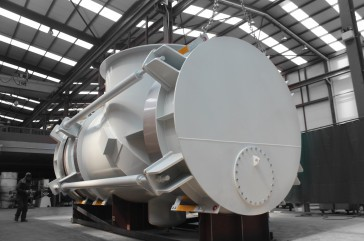 Large elbow pressure balanced expansion joint for energy recovery facility